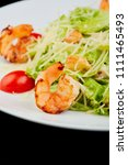 seafood caesar salad with... | Shutterstock . vector #1111465493