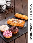 assorted donuts with pink... | Shutterstock . vector #1111466027