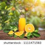 fresh orange juice in bottle on ... | Shutterstock . vector #1111471583