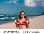 young woman in red bikini with... | Shutterstock . vector #1111478663