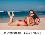 young woman in red bikini with... | Shutterstock . vector #1111478717