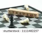 wood word placed on chessboard... | Shutterstock . vector #1111482257