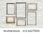 old photo frames on brick wall | Shutterstock . vector #1111627043