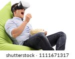 young man using a vr headset... | Shutterstock . vector #1111671317