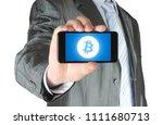 businessman holds smart phone... | Shutterstock . vector #1111680713
