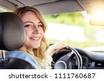 smiling woman in the car on a... | Shutterstock . vector #1111760687