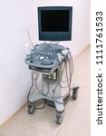 Small photo of stationary ultrasonic scanner in clinic