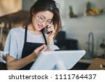 shop assistant taking order on... | Shutterstock . vector #1111764437