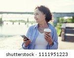 portrait of a mature attractive ... | Shutterstock . vector #1111951223