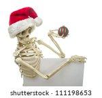 Christmas Skeleton Holding A...