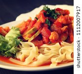 ribbon pasta with arrabiata... | Shutterstock . vector #1112007917