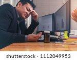 stressed businessman having... | Shutterstock . vector #1112049953