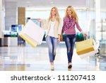beautiful girl with shopping... | Shutterstock . vector #111207413