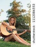 beautiful woman playing guitar... | Shutterstock . vector #1112086553