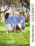 happy family in summer park   Shutterstock . vector #1112100677