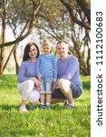 happy family in summer park   Shutterstock . vector #1112100683