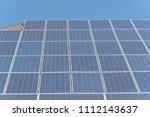 row of solar cell panels... | Shutterstock . vector #1112143637