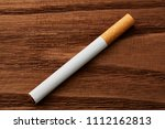 cigarettes close up on a wooden ...   Shutterstock . vector #1112162813