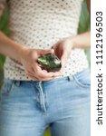 woman hand holding little... | Shutterstock . vector #1112196503