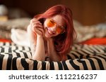 pretty young woman with red... | Shutterstock . vector #1112216237
