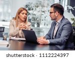 two business colleagues working ...   Shutterstock . vector #1112224397