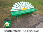 Park bench in the form of chamomile - stock photo