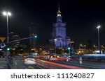 Palace of Culture in Warsaw at night time. Palace of culture was a gift from Stalin to Polish people in 50's. - stock photo