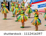 Small photo of Russia, Vladivostok, 06/12/2018. Nice little girls in funny costumes of bees perform the dance on stage. Celebration of annual Russia Day on June 12. Kids' performance. Show and performance.