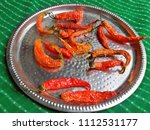 home dried red chilly on a tin... | Shutterstock . vector #1112531177