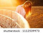 beautiful girl with long hair   Shutterstock . vector #1112539973