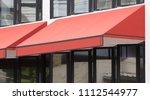 orange awning over glass... | Shutterstock . vector #1112544977