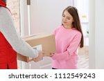 young woman receiving parcel...   Shutterstock . vector #1112549243