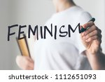 writing hand. woman holds pen... | Shutterstock . vector #1112651093