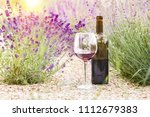 red wine bottle and wine glass... | Shutterstock . vector #1112679383