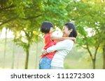 asian mother hugging her... | Shutterstock . vector #111272303