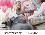 female friend touching tummy of ... | Shutterstock . vector #111283643