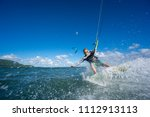 professional kiter makes the... | Shutterstock . vector #1112913113