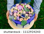 beautiful round cake with blue... | Shutterstock . vector #1112924243
