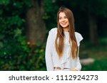 a pretty girl with long hair... | Shutterstock . vector #1112924273