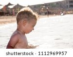 the boy is swimming in the sea. | Shutterstock . vector #1112969957