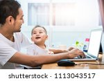 single dad and son using laptop ...   Shutterstock . vector #1113043517