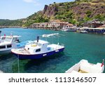 small fishing boats anchored in ... | Shutterstock . vector #1113146507