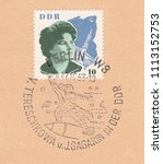 Small photo of GERMANY-CIRCA 1963: A stamp printed in DDR,shows Visit of the Soviet cosmonaut,portrait of Tereshkova.Special postmark Berlin-Soviet cosmonauts with hammer and sickle flying on a rocket,circa 1963