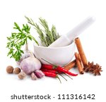 spices and herbs in mortar isolated on white background - stock photo