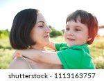 mother hugs the boy. a woman is ...   Shutterstock . vector #1113163757