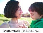 mother hugs the boy. a woman is ...   Shutterstock . vector #1113163763