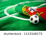 portugal flag and soccer ball... | Shutterstock . vector #1113168173