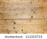 Natural fir wood texture with cracks and knots - stock photo