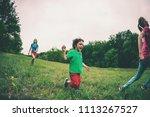 a woman with children runs...   Shutterstock . vector #1113267527