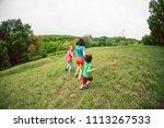 a woman with children runs...   Shutterstock . vector #1113267533